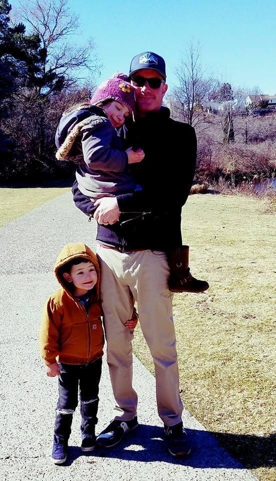 John with his children
