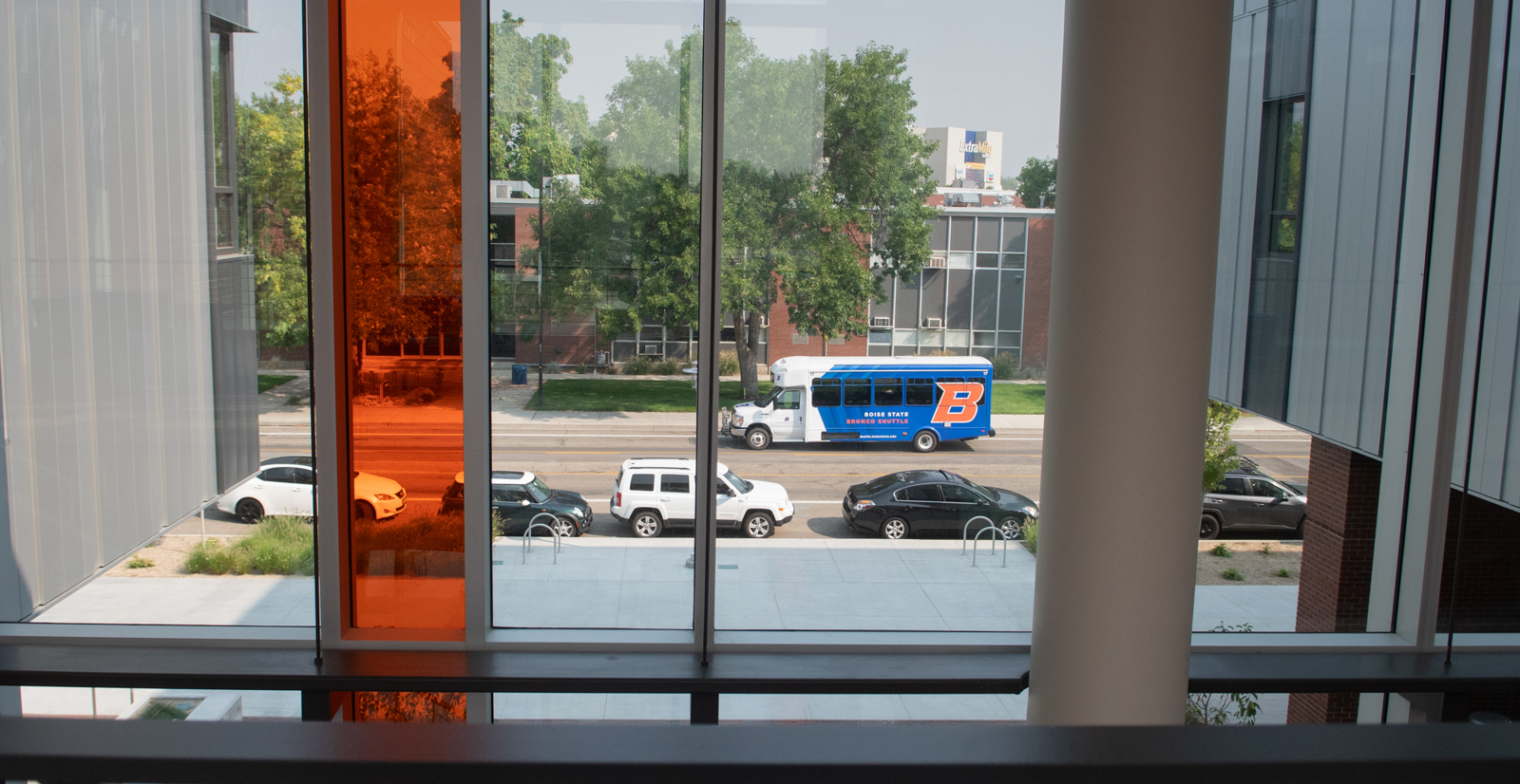 View of cars and shuttle bus on the street from inside the Materials Research building