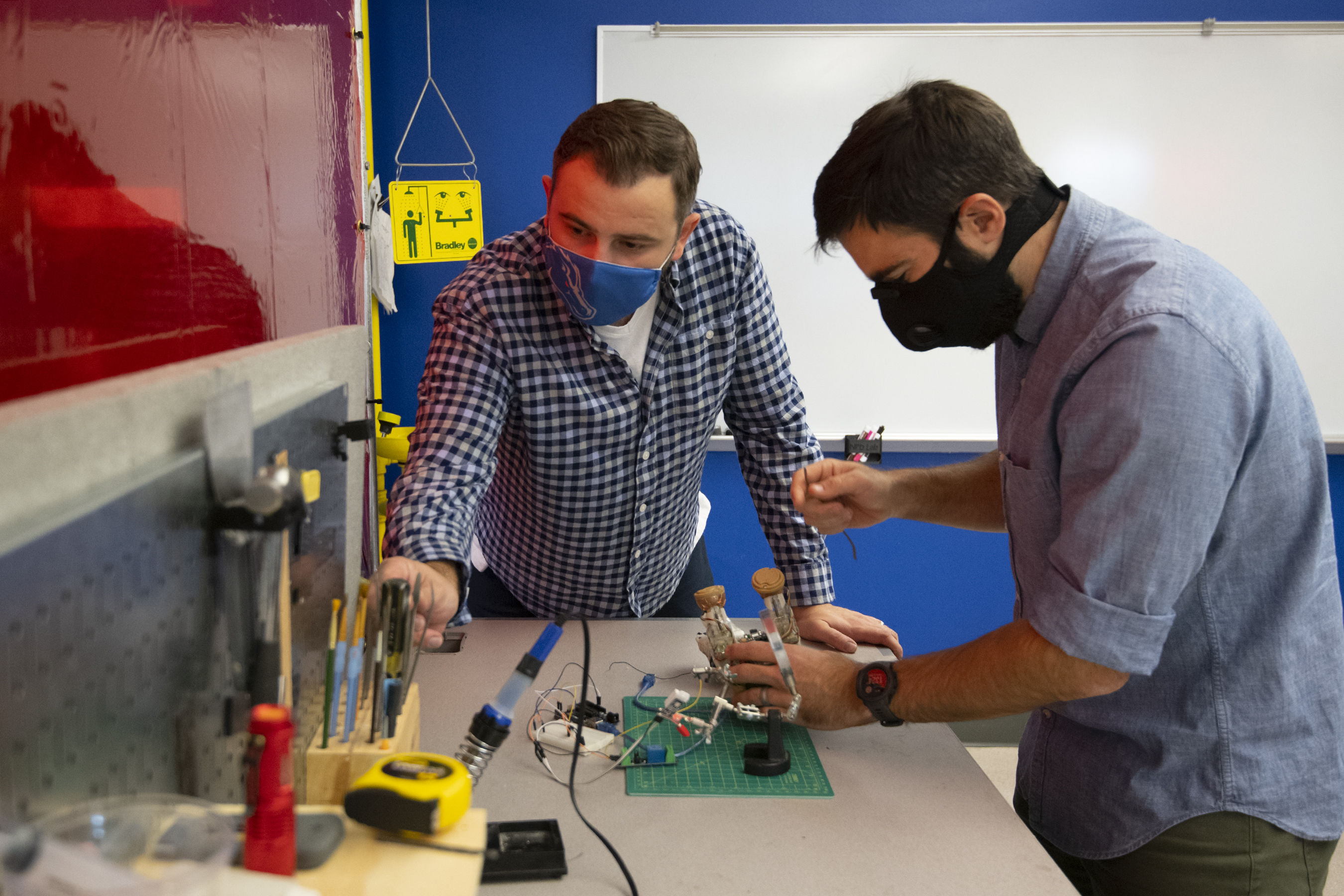 Lab specialist and student design engineer working on a project