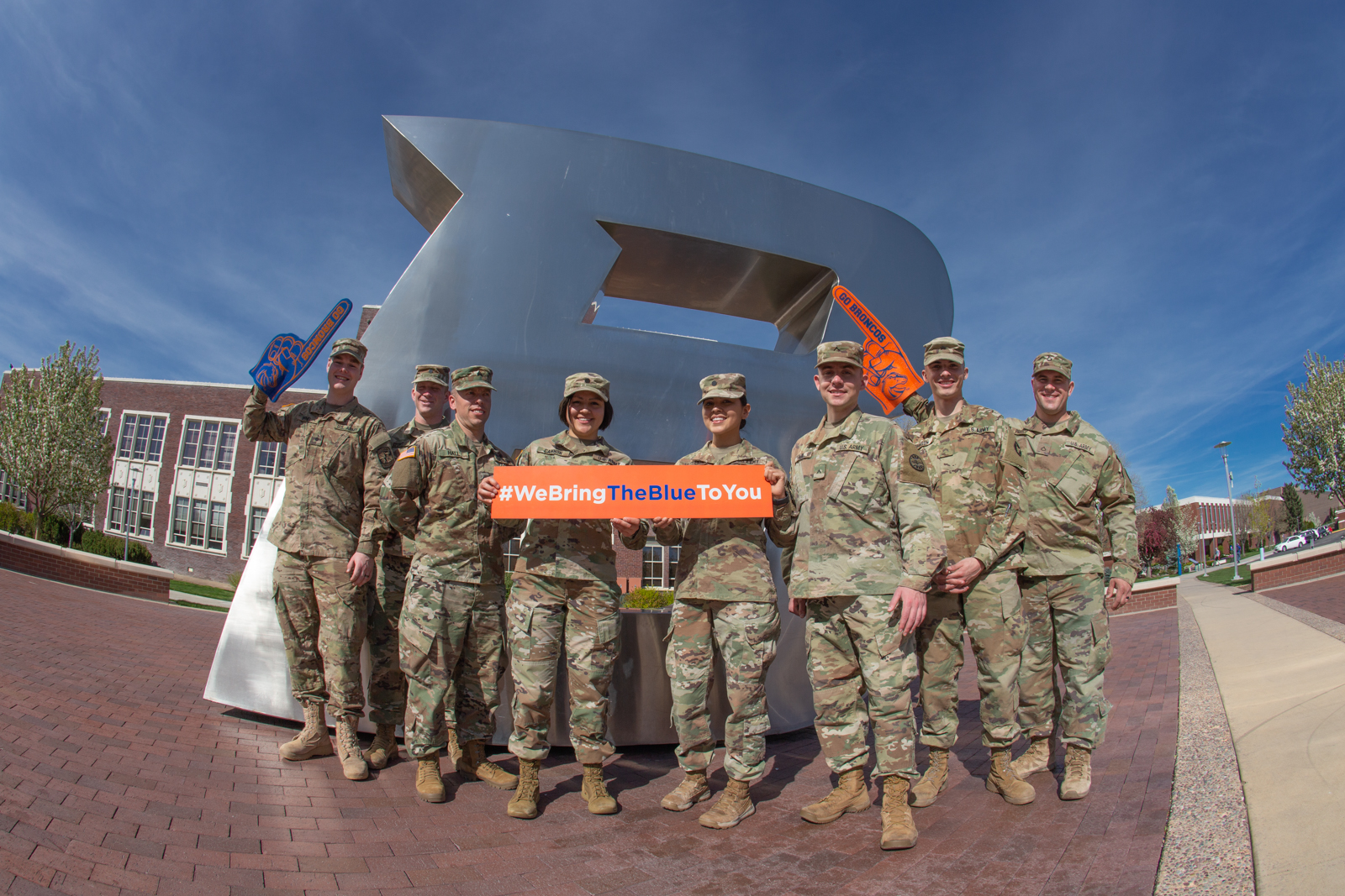 """ROTC group poses in front of the """"B"""" statue."""