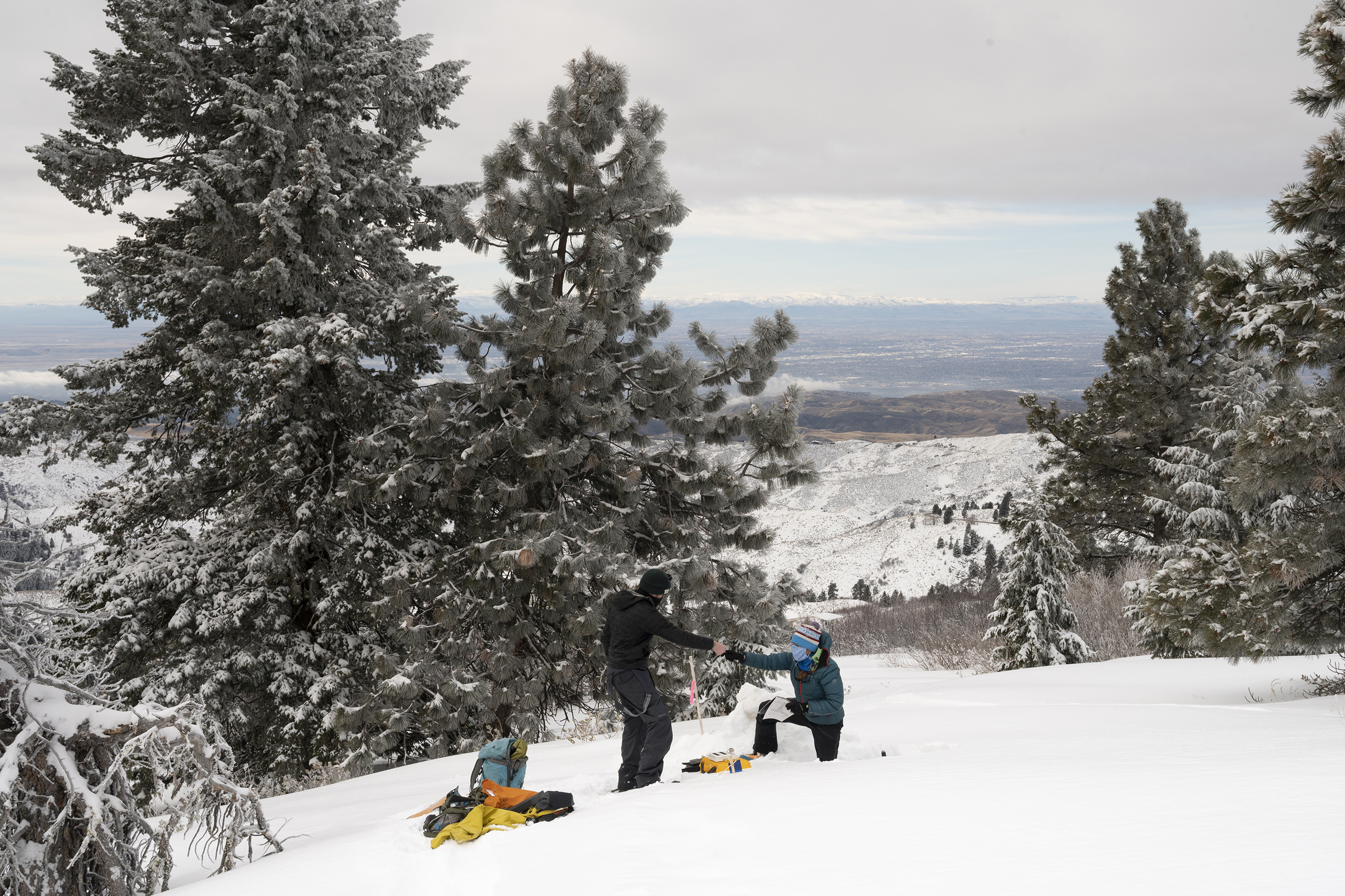students dig on snowy mountainside