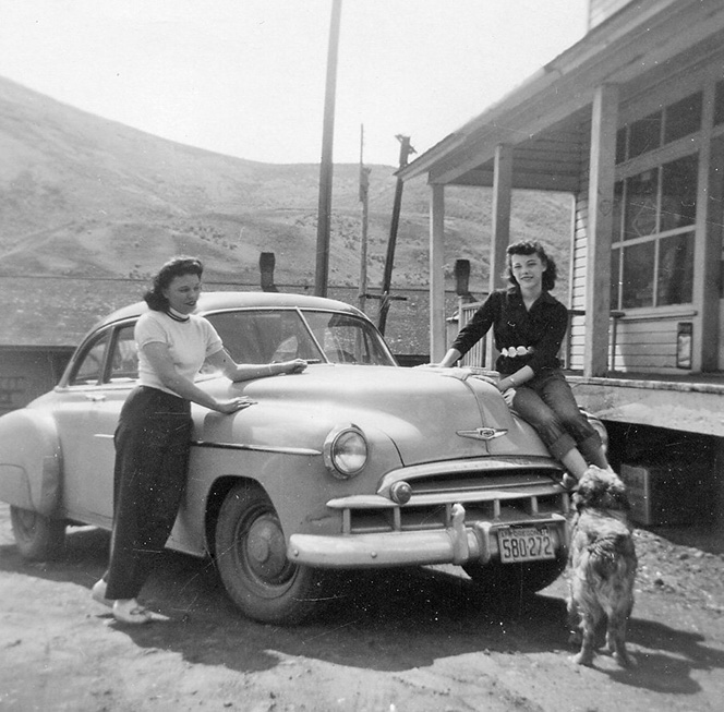 """Postmistress and store owner Francis """"Frankie"""" Carrithers with daughter, Diane, and the family dog. The store was moved to Richland, Oregon where it still stands on Main Street."""