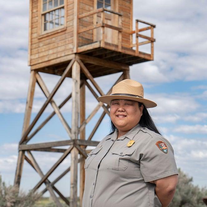 Hanako standing in front of guard tower