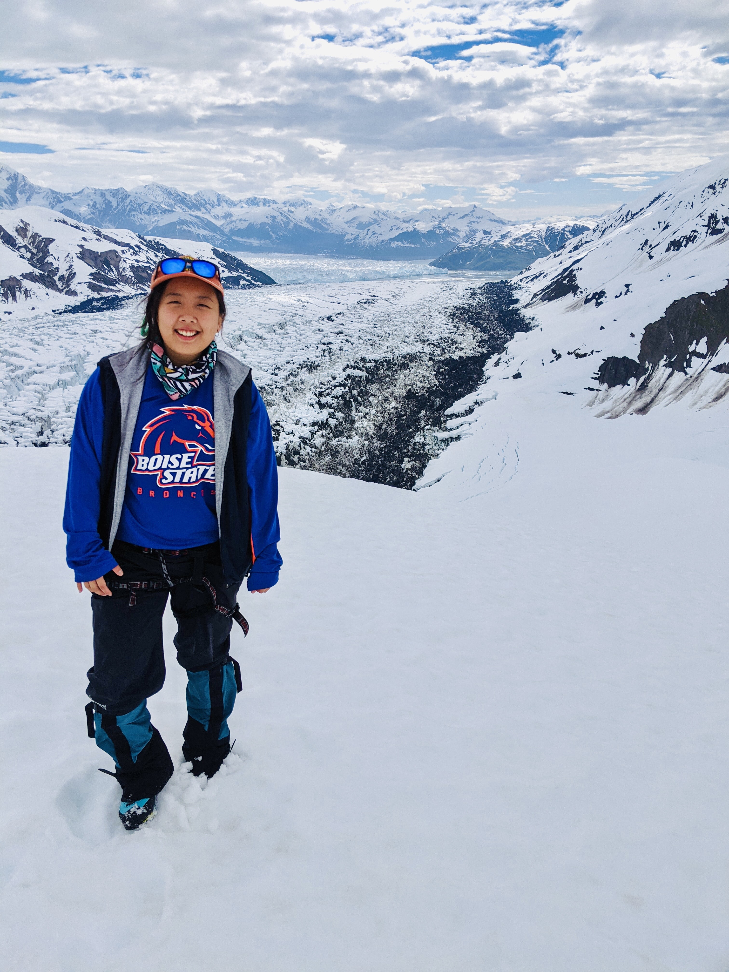 woman stands on glacier
