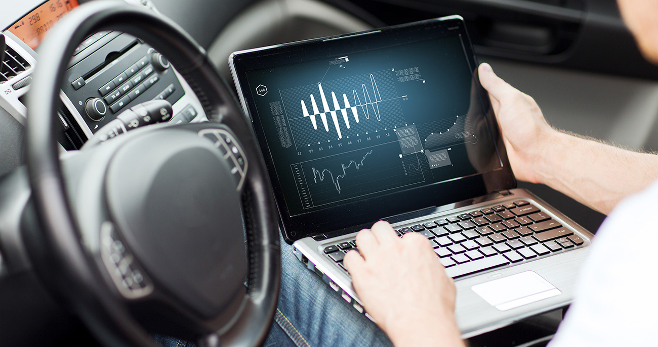 Person using laptop in car