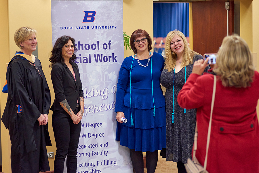 Boise State Online Master of Social Work graduates pose for a photo at a graduation ceremony.