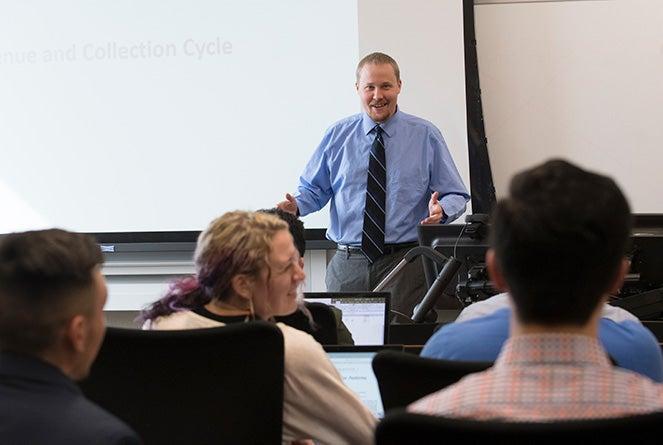 Josh Filzen lecturing in a class at Boise State
