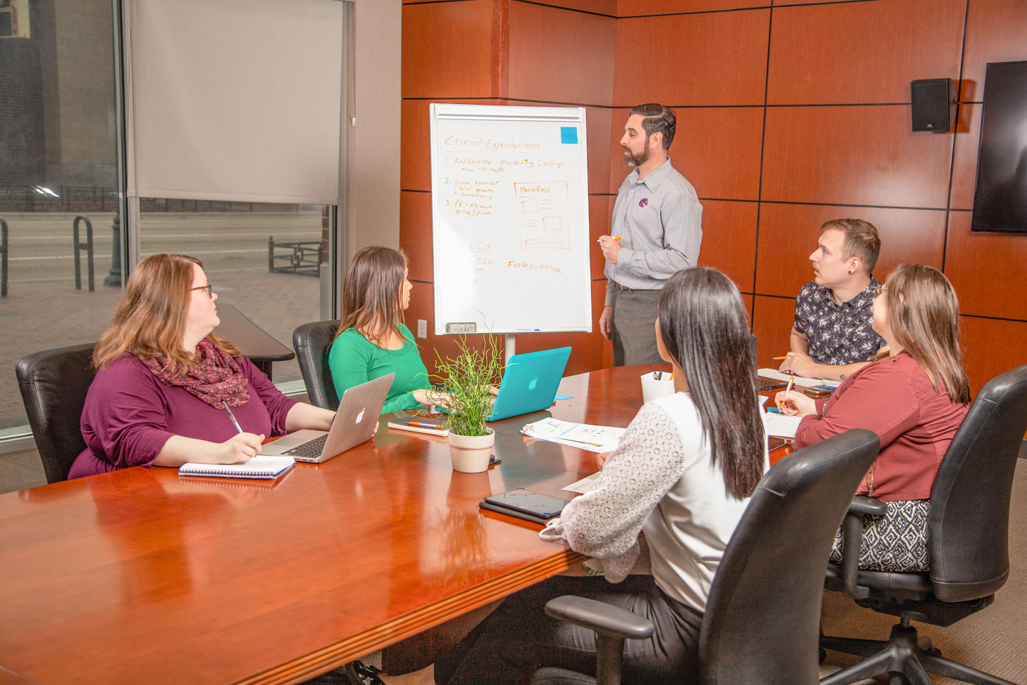 Man in conference room, presenting