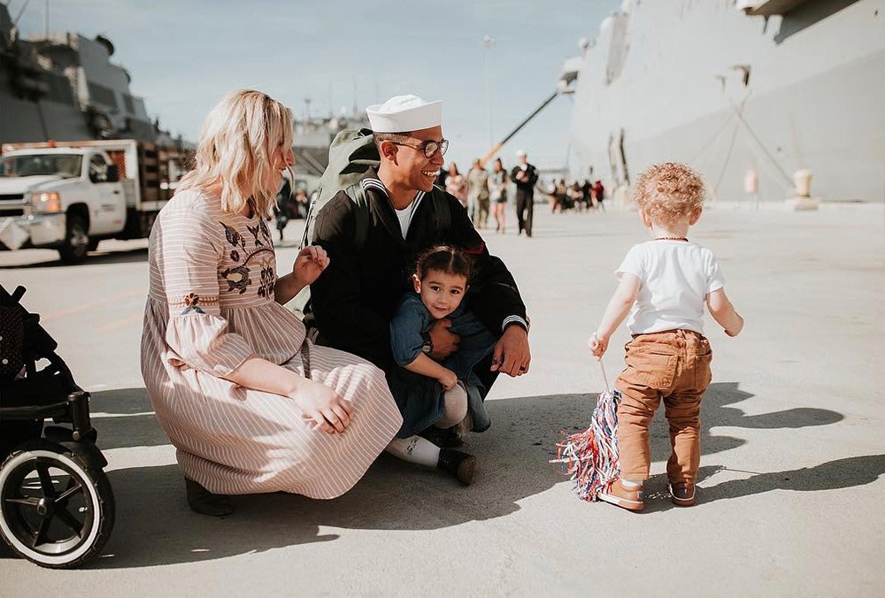 Leonard Rogers and family pictured at navy ship dock.