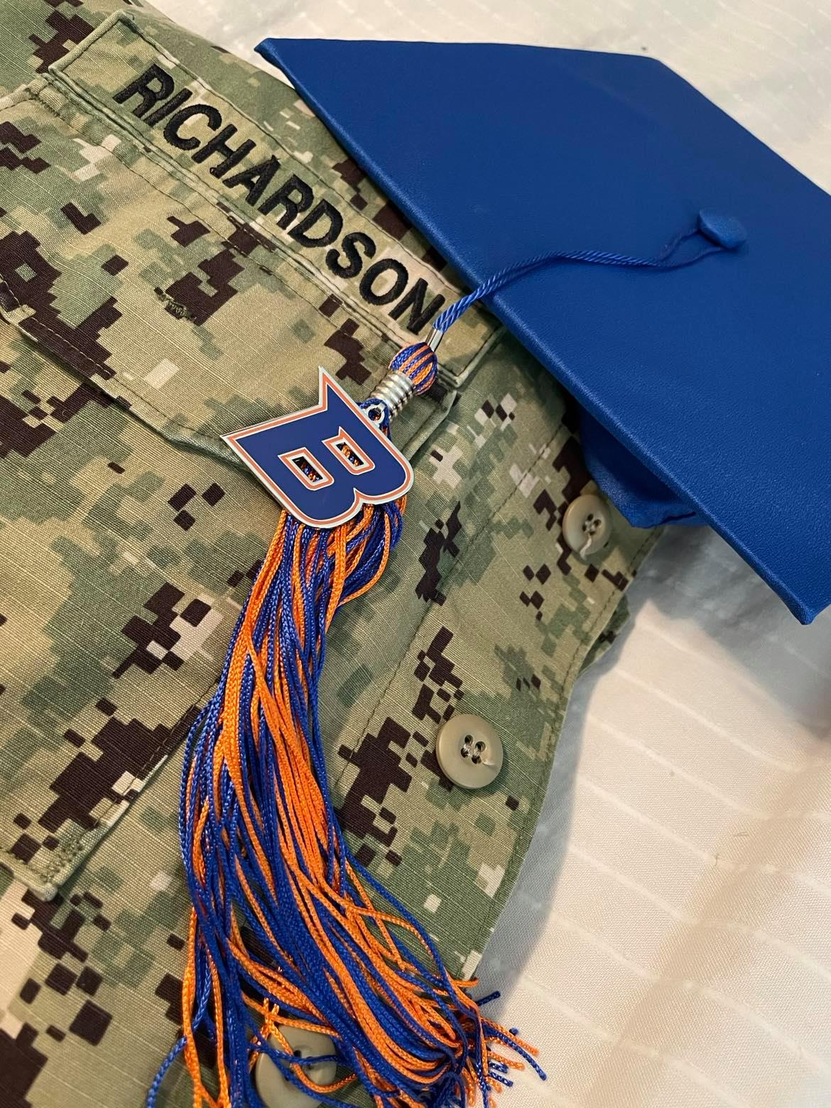 Austin Richardson's Naval uniform is pictured with his Boise State graduation cap.