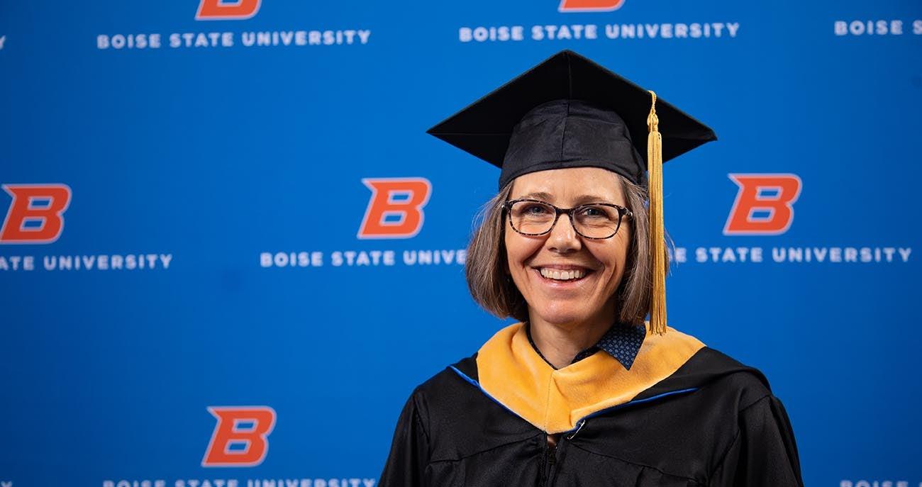 Woman posing for a graduation photo