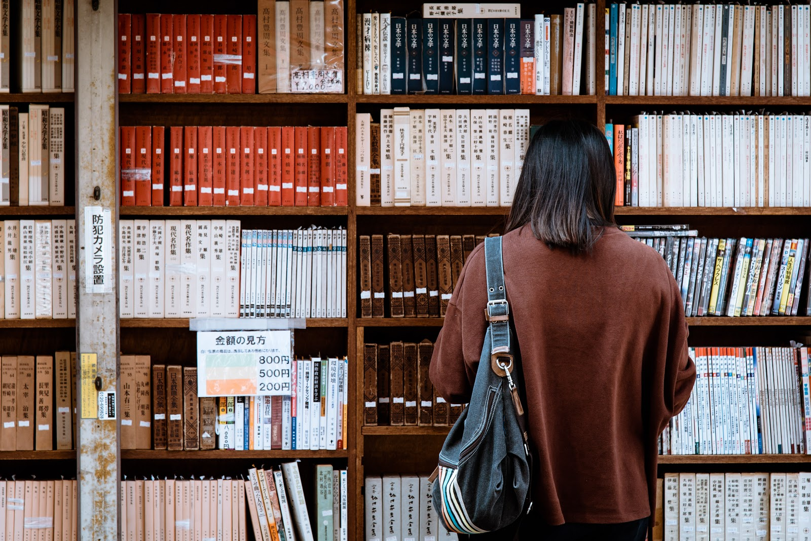 Woman in front of library books