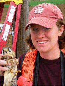 Photo of Erin Wonder holding a bird