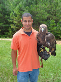 Photo of Christopher Porterfield holding a raptor