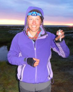 Allie (Alexandra) Anderson with a semipalmated sandpiper. This bird was marked with a transmitter to track it during migration.