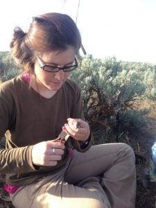 Cinto Mejia taking measurements on a bird