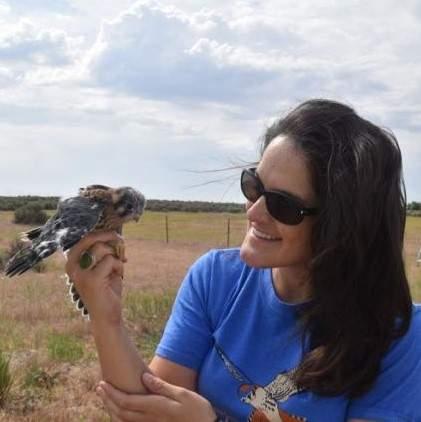 Sarah Schulwitz holding a bird