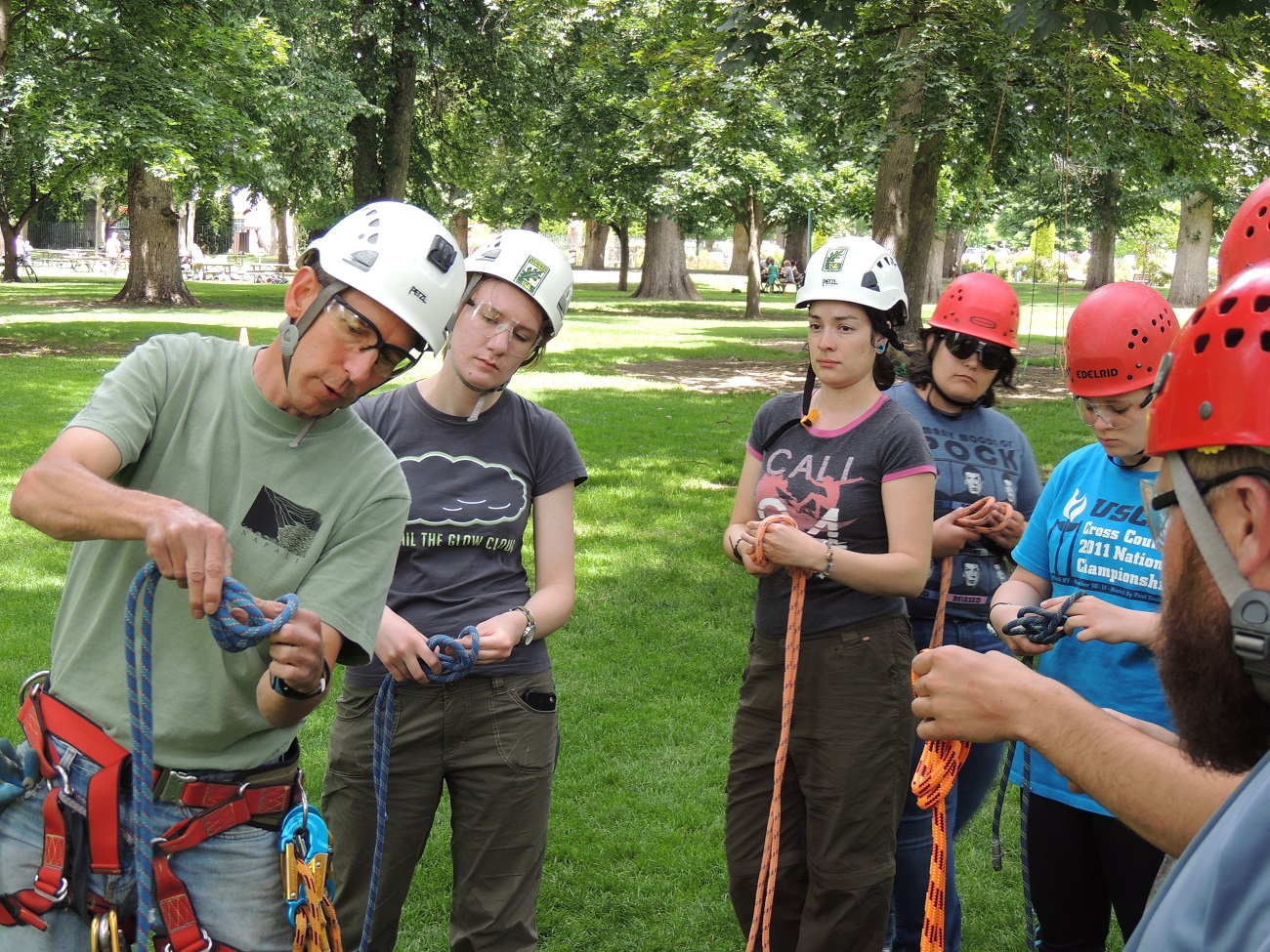 REU students learning climbing techniques in order to access raptor nests