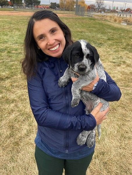 Jen Cruz holding her dog