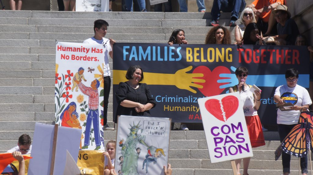 Photo of organizers during the Families Belong Together Rally