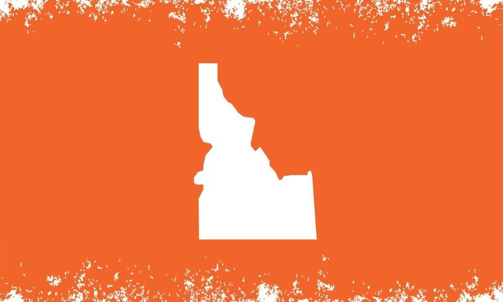 Idaho outline with orange grunge background