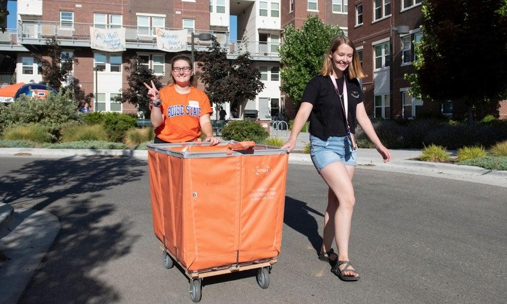 Students pushing a cart