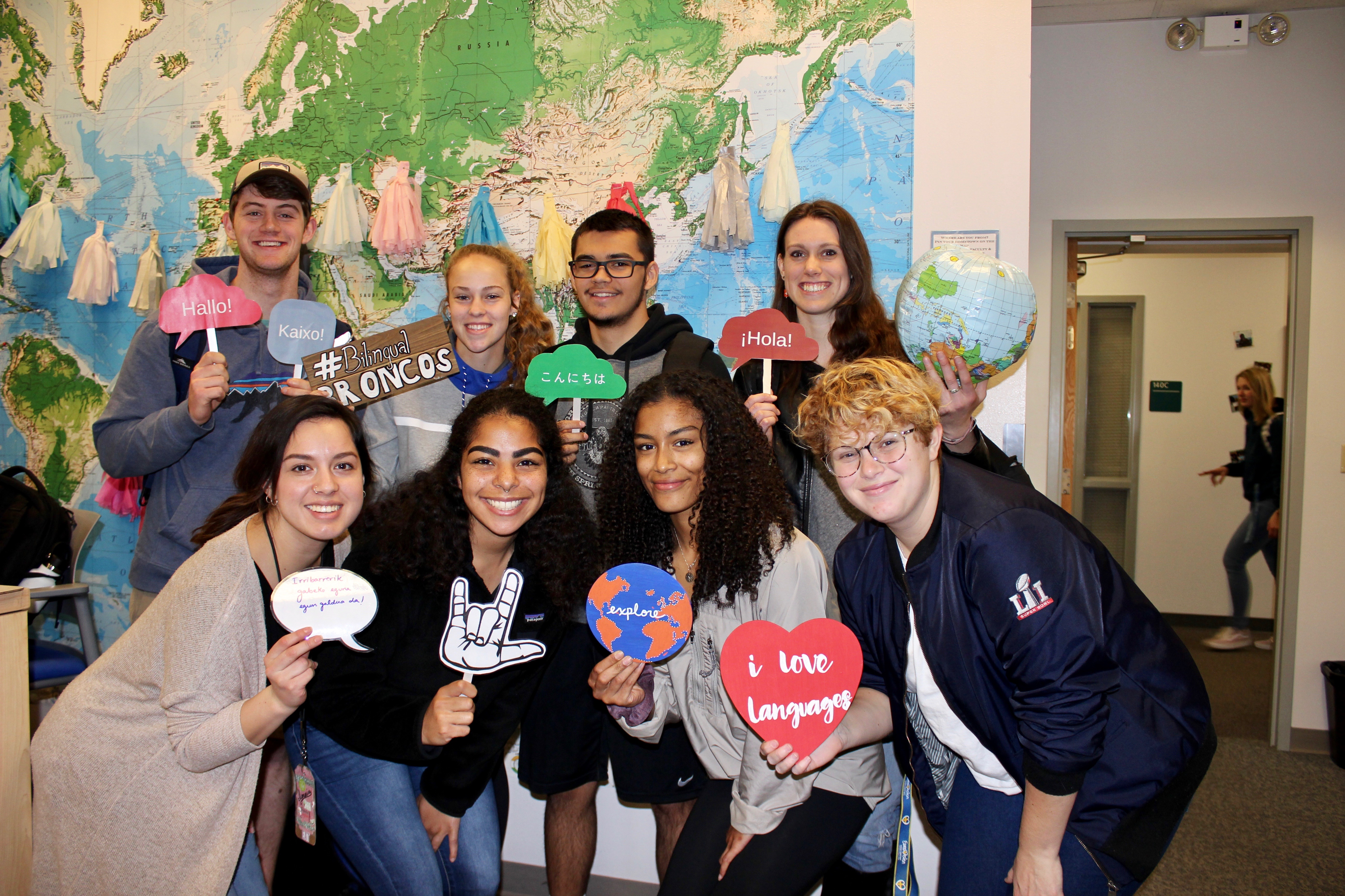 Photo of students in WLRC in front of map with photo booth props